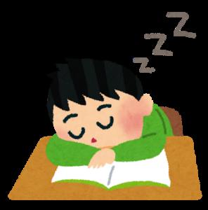 机にうつぶせて寝るぼっち